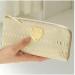 人気のATAOアイボリー×ゴールドのLIMOパイソン財布の口コミは?